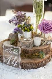 We All Adore This Wedding Centerpieces Idea From The Wood To Its Floral Arrangement And Votive Candles Setting Is Perfect For Rustic Boho