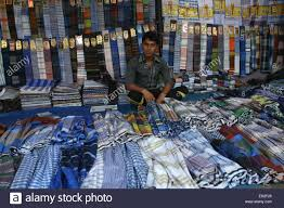 a bangladeshi clothe vendor he waits for customers at a wholesale