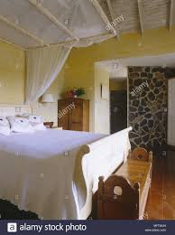 Bedroom With Double Bed Bare Stone Wall Wooden Flooring And Ceiling
