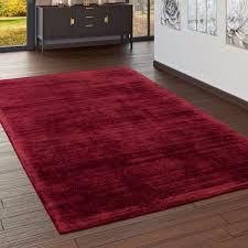 wohnzimmer teppich kurzflor teppich handgearbeitet einfarbig in rot