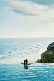 100 Infinity Swimming Luxury Resort Woman Relaxing In Pool Water