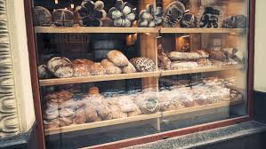 Window In Bakery With Fresh Bread Early Morning Pan Shot