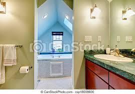 grünes und blaues bad mit whirlpool helle töne