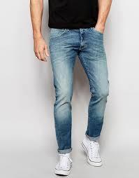 wrangler bryson skinny jeans in green bay in blue for men lyst