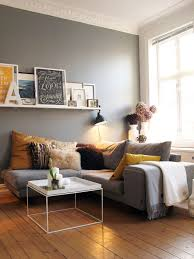Living Room Interiors Inspiration Grey Walls Gray Sofa Mustard Yellow Accents White Floating Shelf With Picture Frames