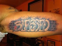 Blessed Graffiti Tattoo On Inner Bicep