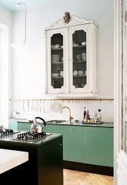 Punch Of Color Brass Dramatically Different Cabinetry Style A Healthy Dose Drama Kitchens That Use Antique Furniture In Lieu Wall Hung