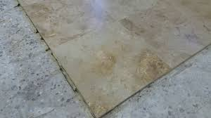 travertine tile floor restoration with lippage free and epoxy