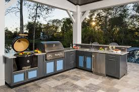 L Shaped Outdoor Kitchen With Bright Cabinets
