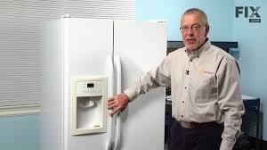 ge refrigerator repair how to replace the dispenser light bulb
