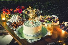 A Small White Wedding Cake With Icing Patterns And Topper That Reads The Best Is