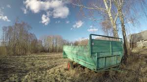 Vintage Tractor Trailer In Old Farm And Clouds Motion Time Lapse 4K Stock Video Footage