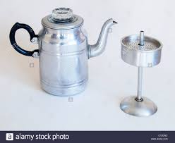 An Old Aluminium Coffee Percolator As Used In The 1940s 1950s On A White Background Opened To Show Filter