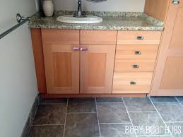 Home Depot Bathroom Sinks And Countertops by Gray Wall Paint Mirror With Wooden Frame Wall Lamps White Granite