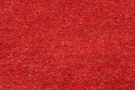 A Closeup Picture Of Clean And Bright Red Carpet Stock Photo
