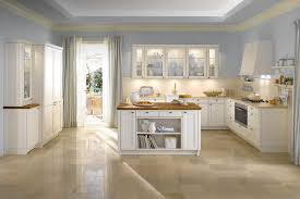 kitchen white cabinets blue gray wall curtains charcoal gray