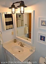 Splash Guard For Bathroom Sink by Rustic Wall Sconces Add Nautical Splash To Bathroom Makeover