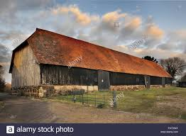 HARMONDSWORTH GREAT BARN, Greater London. Exterior View. Medieval ... Two Story Brick Horse Barn Built In 1888 On The Stanton Ranch Latest Work Sturdibuilt Buildings Sturdibuiltbarnskycom Tennessee Barn Builders Dc Amish Design Allows It To Be Built In A Day Youtube House Plan Pole With Living Quarters True Barns Kit Welch Farm Round 1916 Renovated By For Sale An Incredible Mansion Utah Akers Eertainment Center Porter Wood Newly Country Garden City Vrbo 30 X 40 Garage Kits Custom And Metal 900ss Cafe Racer Return Of Racers