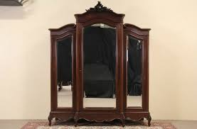SOLD - French Triple Armoire, 1910 Antique Beveled Mirror Doors ... Antique French Louis Xv Style Walnut Triple Armoire Bedroom Nice Details About Triple Armoire 1910 Wardrobe Wardrobes With Mirror Imposing Black Rustic Wardrobe Blackcrowus Sold Beveled Doors Chantilly White The Cotswolds Edinburgh Natural Solid Oak Large Fniture Land Antique French Triple Armoire Wardrobe Linen Cupboard1100 My Devon Painted Pine Cupboard Ebay Drawer Amazing Drawers Tilson