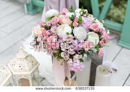 Wedding Reception Flower Decorations Rustic Style Bridal Bouquet And Candles On Wooden Vintage Background