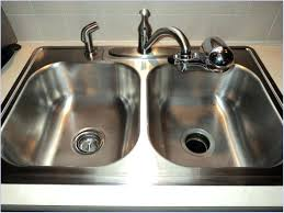clogged double kitchen sink garbage disposal unclog standing water