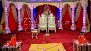 Traditional Royal Open Mandap With Ornate Fabric Drapes Red Gold White Blue