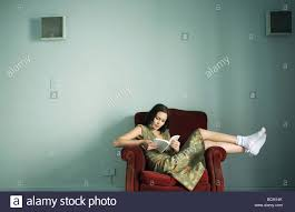 Woman Sitting In Armchair Reading Book, Wearing Dress And Socks ... Young Beautiful Woman Reading A Book In White Armchair Stock 1960s Woman Plopped Down In Armchair With Shoes Kicked Off Tired Woman In Armchair Photo Getty Images With Fashion Hairstyle And Red Sensual Smoking Black Image Bigstock Beautiful Business Sitting On 5265941 And Antique Picture 70th Birthday Cake Close Up Of Topp Flickr Using Laptop Royalty Free Pablo Picasso La Femme Au Fauteuil No 2 Nude Red 1932 Tate Sexy Sits 52786312