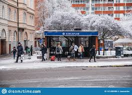 100 Karlaplan Metro Station With People Walking In And Out On A