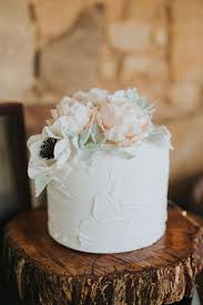 Single Tier White Buttercream Wedding Cake Topped With Pastel Sugar Peonies And Anemones On A Rustic