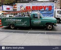 Old Pick-up Truck Parked Next To Sidewalk, Sleepy's Van Behind Stock ...