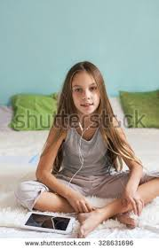 pre teen relaxing bed listening stock photo 328631696