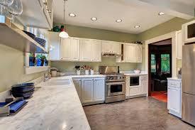 peronda tile granite flooring kitchen with white cabinets