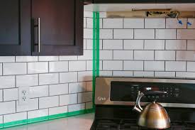 Polyblend Ceramic Tile Caulk Drying Time by How We Installed Our Subway Tile Backsplash Brittany Stager
