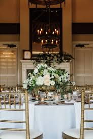Wedding Reception In Room With Fireplace Chandelier Rustic Tall Mirror And Low Centerpiece