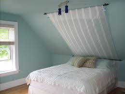 Lighting For Sloped Ceilings by Bedrooms With Angled Ceilings Sloped Ceiling Bedroom Sloped