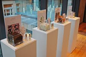 A Display Showcased The Main Notes In Fragrance Including Ambrette Jasmine And