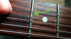 Move Your Strings Aside And Take A Look Underneath For Evidence Of Fret Wear The