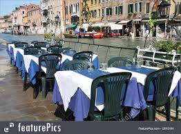 Europe: Outdoor Restaurant Tables And Chairs Next To A Canal In Venice,  Italy Designer Fniture Italian Interior Design Cappellini Billiani Chairs And Fniture A Little Italy Tiny Restaurant Thats Too Good To Be A Secret Rome View Of An Outdoor Tables Home Artisan Bellevue Very Wood Chair Makers The 100 Best Restaurants In Paris Restaurants Time Out Zin Eclectic Modern Industrial Style Melfis New Charleston Sc Restaurant Table Wikipedia Sunperry Fniture Project For Choice