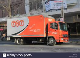 TNT Express Track Parks In Downtown Melbourne Australia. TNT Express ... Overturned Fedex Truck Shuts Down Part Of I95n In Westwood Necn Tnt Express Track Parks Dtown Melbourne Australia Express Pickup And Delivery Service Options Freight Ltl Shipping Forms Canada Hazardous Materials Forecasts Record Volume This Holiday Season Volvo Trucks Successfully Demonstrate Platooning On Advanced Shipment Tracking Web Shoppers Beware To Charge By Package Size Wsj Caught Video Uta Frontrunner Train Crashes Into Truck