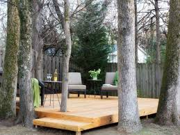 Distance Between Floor Joists On A Deck by How To Build A Tree Encompassing Deck Hgtv