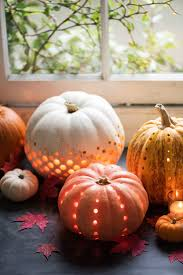 Pumpkin Carving W Drill by 33 Spoooky Halloween Outdoor Decorations Pumpkin Drilling