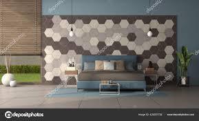 modernes schlafzimmer mit doppelbett vor einer wand mit