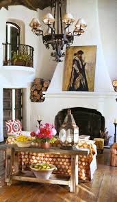 Casa Mexicana Spanish Colonial Style Home With White Plaster Fireplace Wrought Iron Balcony Chandelier And Rustic Furniture