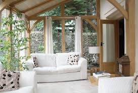 White Sunroom Furniture With Wood Accent Of Structure Material And Slopped Ceiling Expose