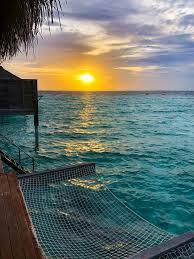 100 Anantara Kihavah Maldives Villas Sunset On Water