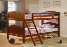 brown stained oak wood bunk beds with red cover bed set and stairs