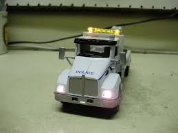 Custom 1 43 Scale Kenworth Diecast Nypd Wrecker Tow Truck With ... Best Of Extreme Custom Toy Trucks All About Vintage Marx Sears Allstate Toy Semi Truck And Trailer Pressed Steel Wwe 164 Scale Diecast Undtaker Semitruck Toys Games The Images Collection Of Yrhyoutubecom Scale Rhscalefabcom Amazoncom Large Big Rig Long Freightliner Haul Trucker Newray Ca Inc Mis Camiones Dcp Trucks Pinterest Rigs Transportation Stress Balls Cars More Qlp Vehicles Kohls Red White Flames Peterbilt Farm Ebay Rhpinterestcom Dcp