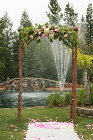 Wedding Flowers Ideas Outdoor Rustic Arch Design Matched With Natural Tree Stem Pillar And
