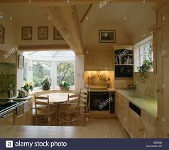 Oven In Lighted Alcove Country Kitchen With Circular Wooden Table Window Of Small Diningroom Extension