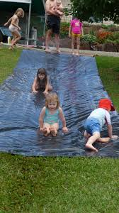 Make Your Own Water Slide. Sheet Of Black Plastic And A Hose. I ... 25 Unique Slip N Slide Ideas On Pinterest In Giant Backyard Water Parks Splash Recycled Commerical Water Slides For Sale Fix My Slide Diy Backyard Outdoor Fniture Design And Ideas Residential Pool Pools Come Out When Youre Happy How To Turn Your Into A Diy Pad 7 Genius Hacks Sprinklers The Boy Swimming Pools Waterslides Walmartcom N But Combing Duct Tape Grommets Stakes 54 Best Images Summer Fun 11 Infographics Freeze